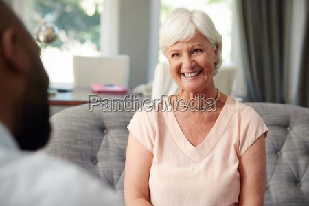 happy senior woman taking financial advice