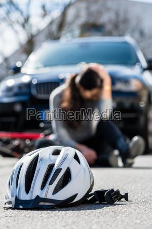 bicycling helmet on the asphalt after