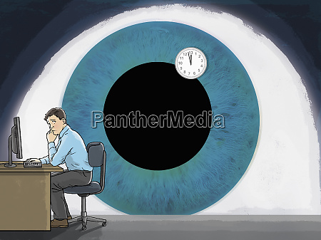 large eye surveilling man at desk