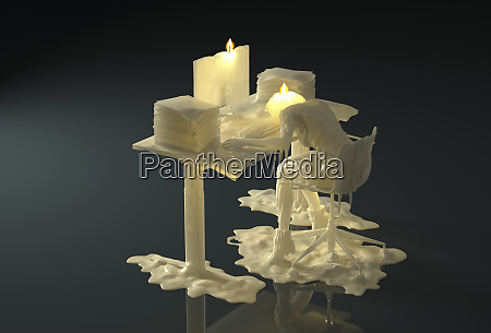 melting wax candle of businesswoman working