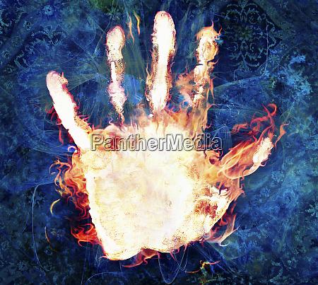 flames burning on human hand