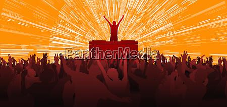 crowd cheering performer in nightclub