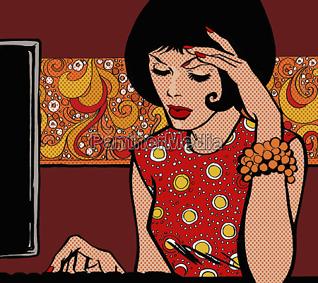 woman concentrating typing on computer