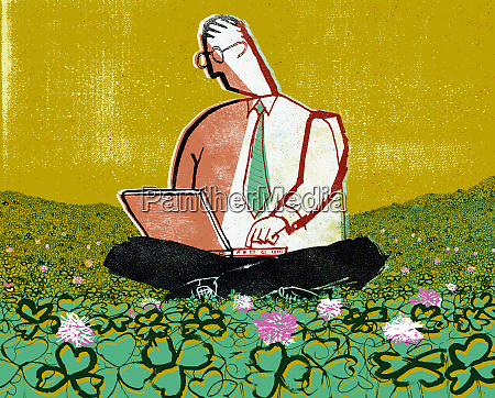businessman sitting in clover using laptop