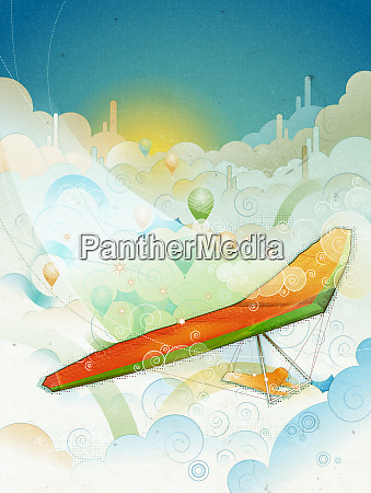 man hang gliding through clouds
