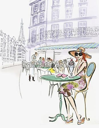 woman enjoying milkshake at sidewalk cafe