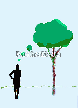 businesswoman thinking of green tree thought