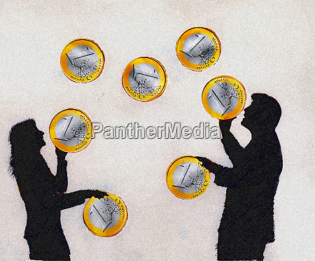 businessman and businesswoman juggling euro coins