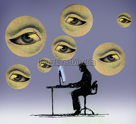 businessman working on computer surrounded by