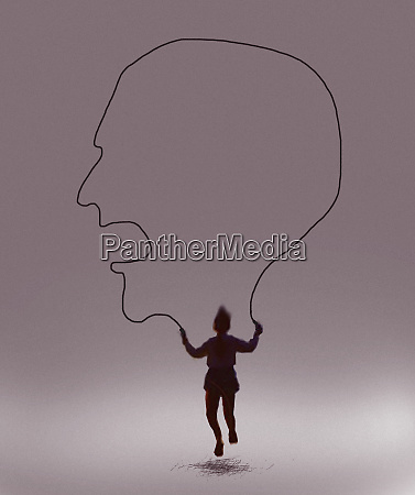 young girl skipping with skipping rope