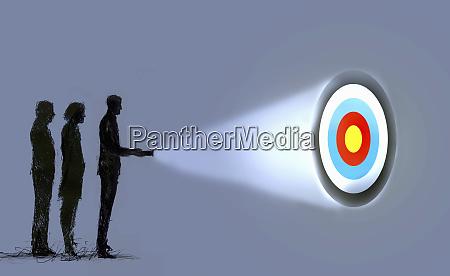 business people shining light on target
