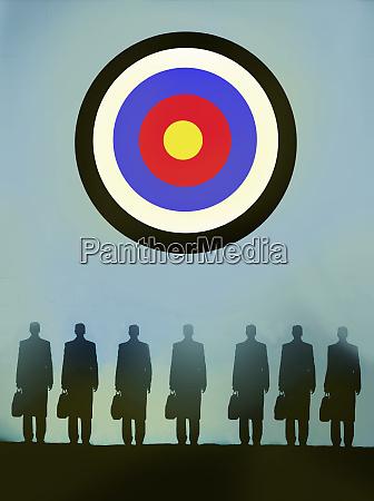 row of businessmen standing in front