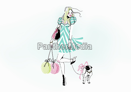 glamorous young woman carrying shopping bags