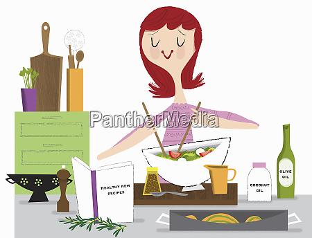 young woman making healthy salad using