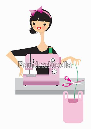 kvinde der bruger symaskine