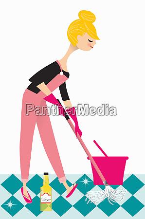 kvinde opsamlings gulv med eddike