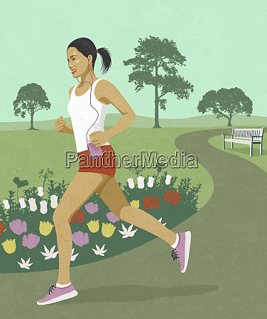 young woman jogging in park listening