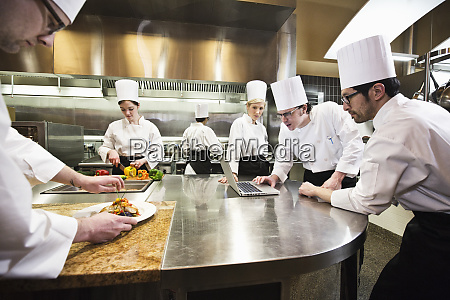 a crew of chefs working in