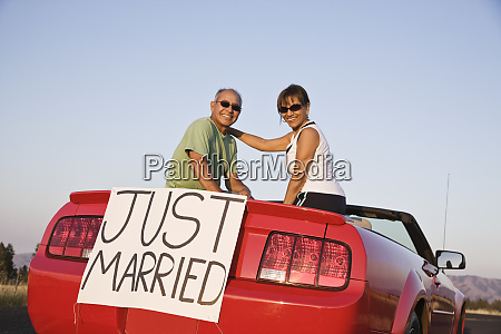a senior couple just married sitting