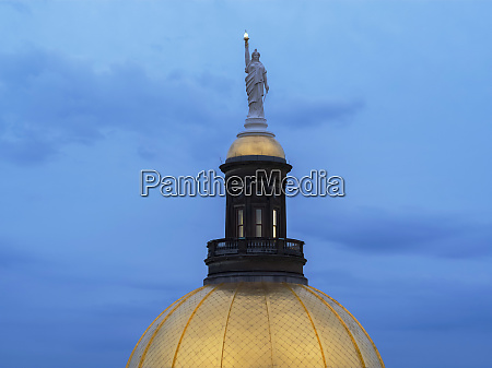 statue on top of dome of