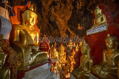 gold buddha statues line the sides
