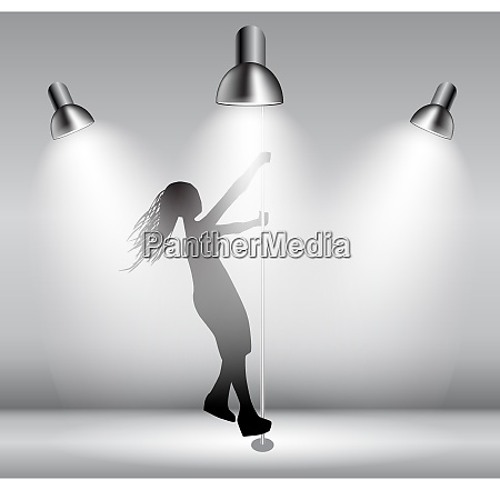 silhouette of dancing striptease girl on