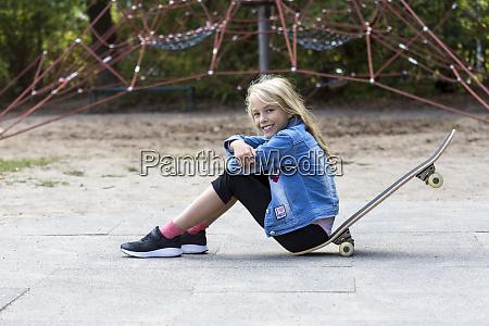 portrait of smiling blond girl sitting
