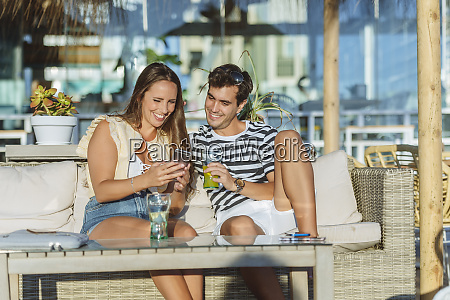 happy young couple sitting on the