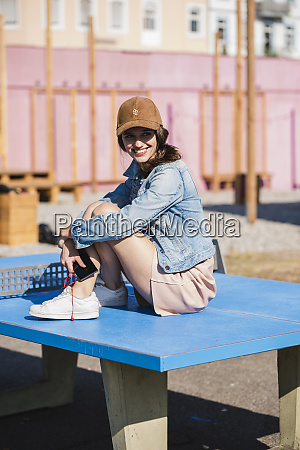 smiling young woman with cell phone