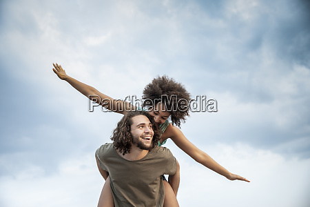 happy carefree couple outdoors