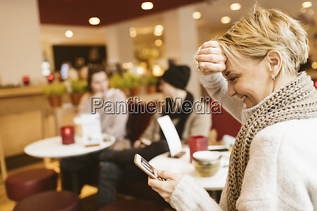young happy woman using smartphone in