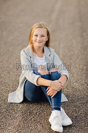 portrait of smiling girl sitting on