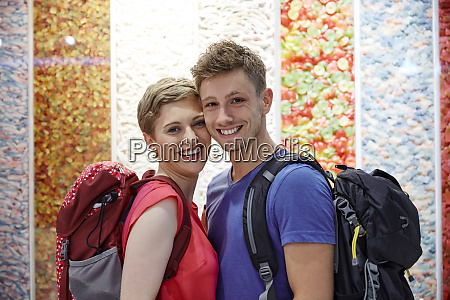portrait of happy couple with backpacks
