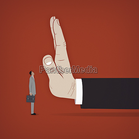 large hand stopping small businessman