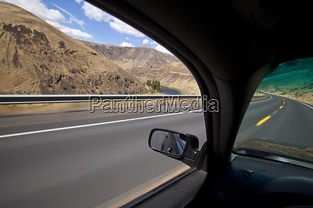 car driving on road through yakima