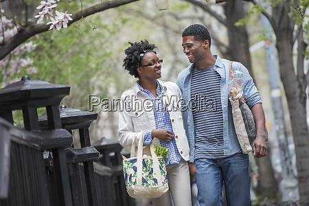 a couple walking in the park