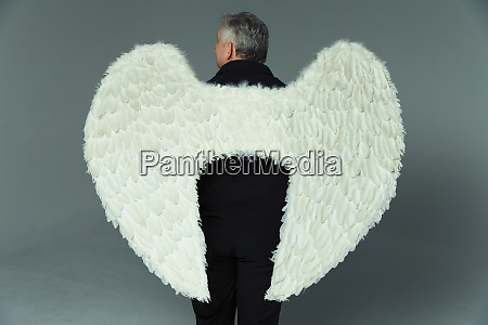serene, man, wearing, angel, wings - 27457286
