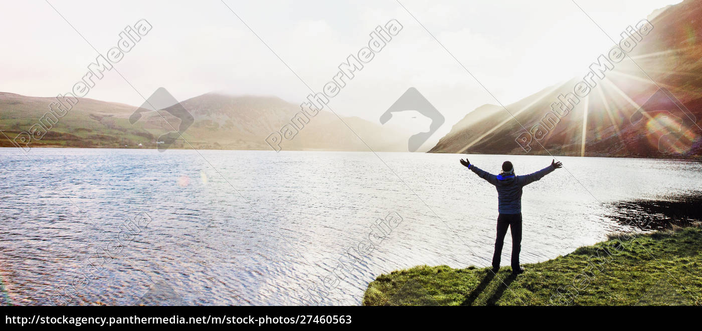 excited, man, at, sunny, lake - 27460563