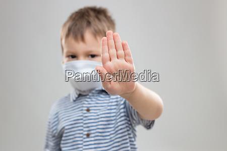 young child wearing a respiratory mask