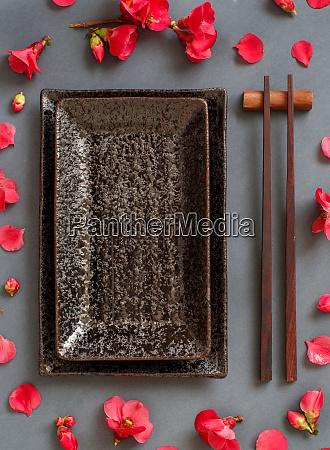 chopsticks rectangular plate and pink flowers