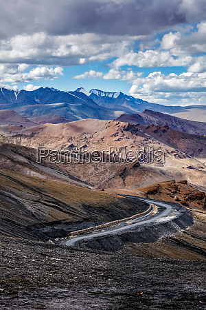 road in himalayas with mountains
